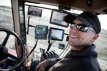 istock_photo_-_farmer_and_cab_technology