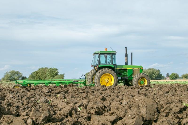 Older John Deere tractor with new tires