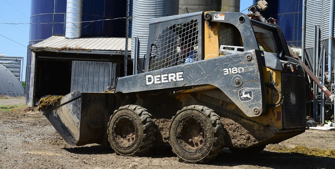 John Deere Skid Steer with Galaxy Muddy Buddy tires